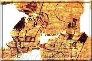 一张埃及妇女用镜子化妆的残缺画面